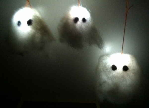 Three needlefelted ghosts, glowing