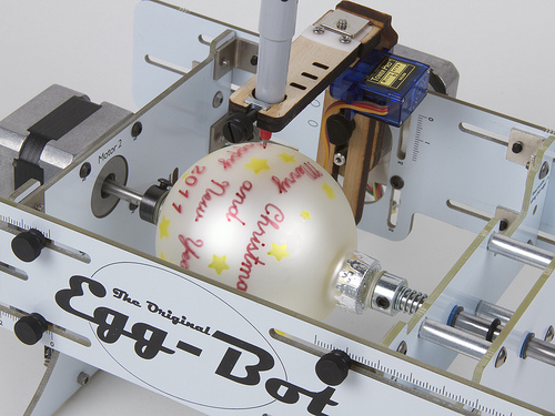 Ornament being decorated by EMSL's Egg-Bot