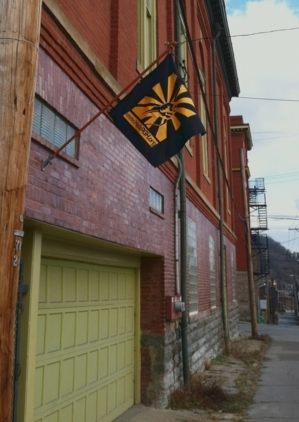 HackPittsburgh's flag, flying at an angle over the door